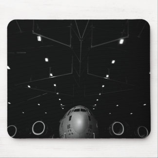 A C-17 Globemaster III sits in a hangar Mouse Pad