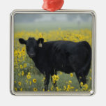 A calf amid the sunflowers of the Nebraska Metal Ornament