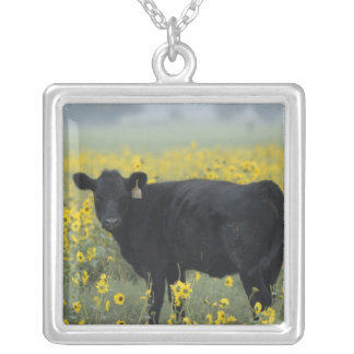 A calf amid the sunflowers of the Nebraska Square Pendant Necklace
