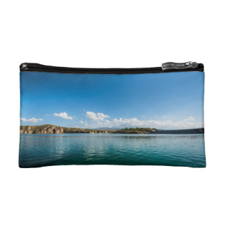 A calm lake in which the sky is reflected cosmetic bag