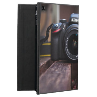 A camera on a table iPad air covers