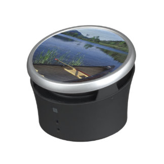 A canoe rests on the shore of Little Long Pond Bluetooth Speaker