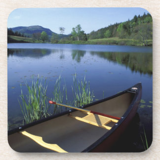 A canoe rests on the shore of Little Long Pond Beverage Coaster