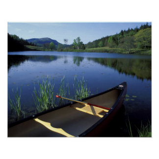 A canoe rests on the shore of Little Long Pond Poster