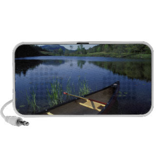 A canoe rests on the shore of Little Long Pond Speaker