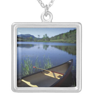 A canoe rests on the shore of Little Long Pond Square Pendant Necklace