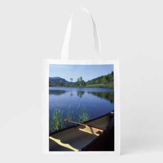 A canoe rests on the shore of Little Long Pond Market Totes
