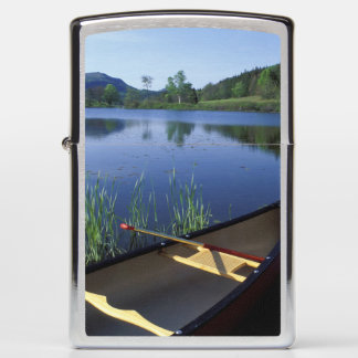 A canoe rests on the shore of Little Long Pond Zippo Lighter