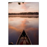 A canoe rests on the shore of Pawtuckaway Lake Card