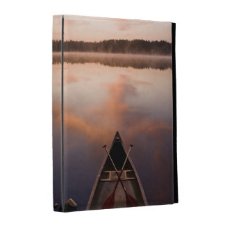 A canoe rests on the shore of Pawtuckaway Lake iPad Cases
