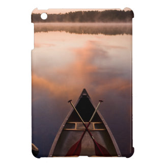A canoe rests on the shore of Pawtuckaway Lake iPad Mini Covers