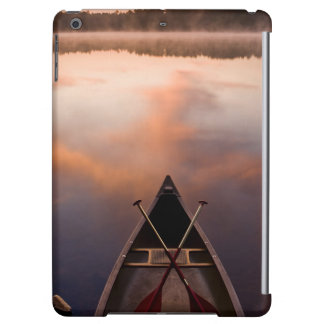 A canoe rests on the shore of Pawtuckaway Lake iPad Air Cases