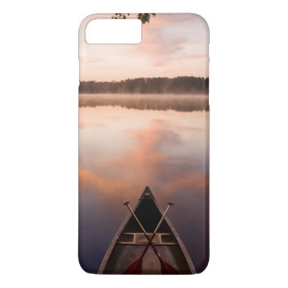 A canoe rests on the shore of Pawtuckaway Lake iPhone 7 Plus Case
