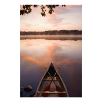A canoe rests on the shore of Pawtuckaway Lake Photo Print