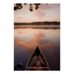 A canoe rests on the shore of Pawtuckaway Lake Poster
