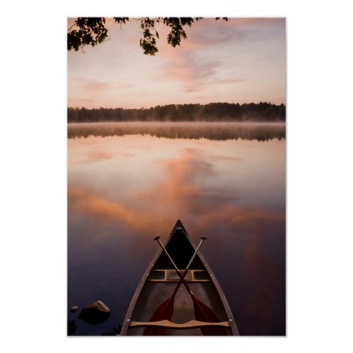 A canoe rests on the shore of Pawtuckaway Lake Posters