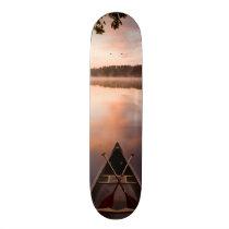 A canoe rests on the shore of Pawtuckaway Lake Skateboard Deck