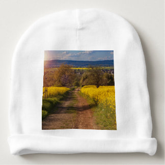A canola field in spring baby beanie