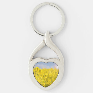 A canola field in spring Silver-Colored Heart-Shaped metal keychain