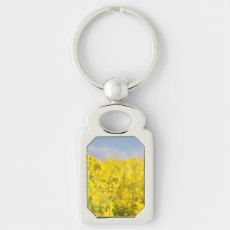A canola field in spring Silver-Colored rectangular metal keychain