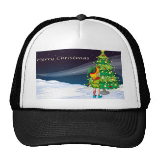 A card with an elf facing the christmas tree trucker hat