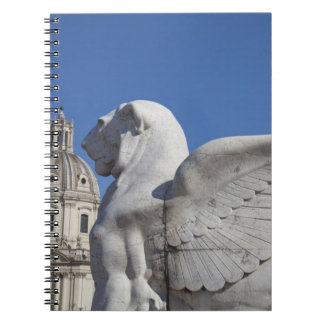 A carved winged lion at the front of the Victor Spiral Notebook