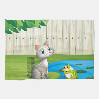 A cat and a frog inside the fence kitchen towels