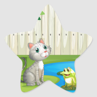 A cat and a frog inside the fence star sticker