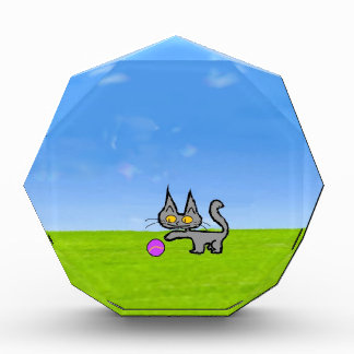 A cat Playing Outside With Purple Tennis Ball Award