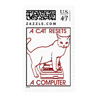 A cat resets a computer postage