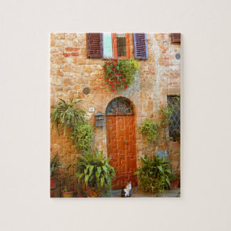 A cat seeks entrance to home in Pienza, Italy. Jigsaw Puzzle