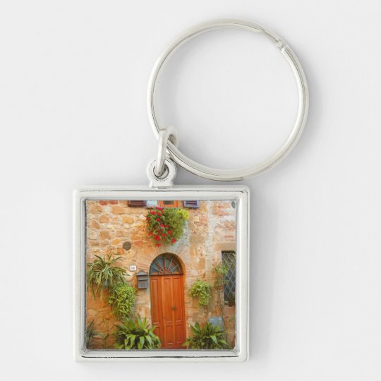 A cat seeks entrance to home in Pienza, Italy. Keychain
