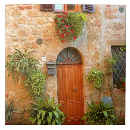 A cat seeks entrance to home in Pienza, Italy. Large Square Tile