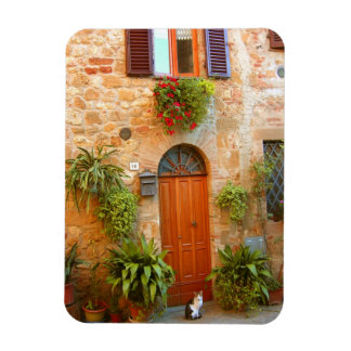 A cat seeks entrance to home in Pienza, Italy. Magnet