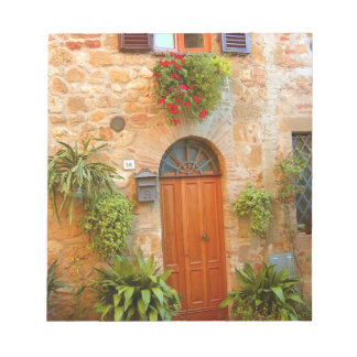 A cat seeks entrance to home in Pienza, Italy. Note Pad