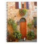 A cat seeks entrance to home in Pienza, Italy. Spiral Notebooks