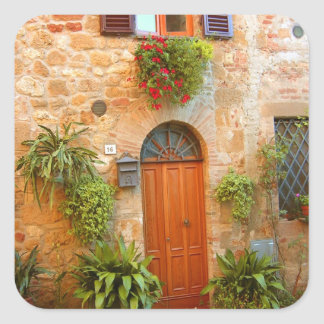 A cat seeks entrance to home in Pienza Italy Square Sticker