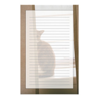 A Cat Sitting Behind The Curtains On A Window Stationery