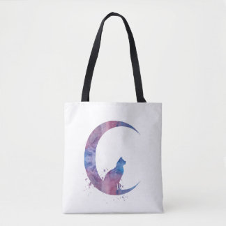 A cat sitting on the moon tote bag