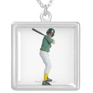 a caucasian male child dressed as a baseball necklace