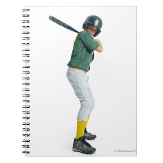 a caucasian male child dressed as a baseball notebook