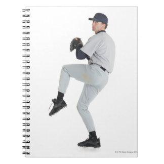 a caucasian man wearing a white baseball uniform notebook