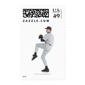 a caucasian man wearing a white baseball uniform postage stamps