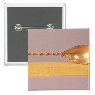 A ceremonial spoon pinback button