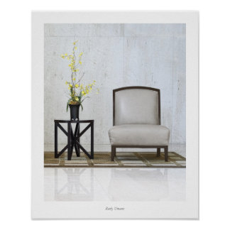 A chairs and a table with a plant poster