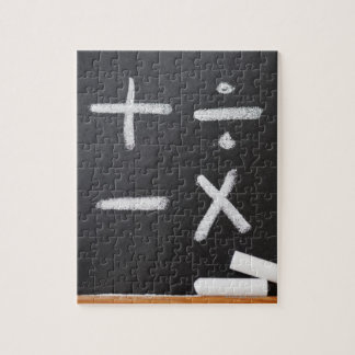 A chalkboard with mathematic symbols on it jigsaw puzzle