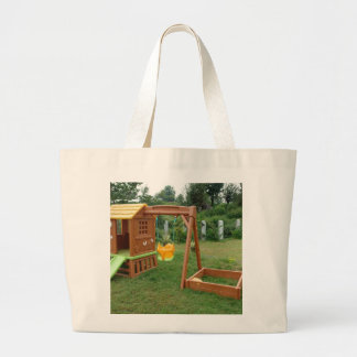 A child s playing equipment in a green location canvas bags