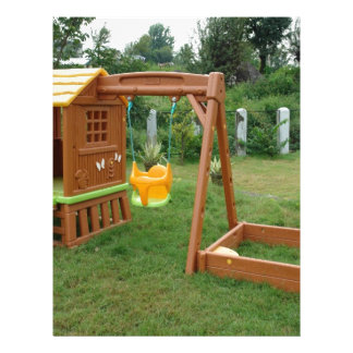 A child s playing equipment in a green location custom letterhead