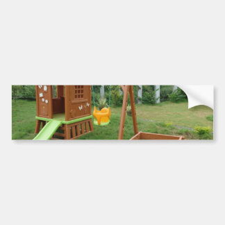 A child's playing equipment in a green location bumper stickers