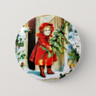 A christmas greeting with a baby holding christmas button
